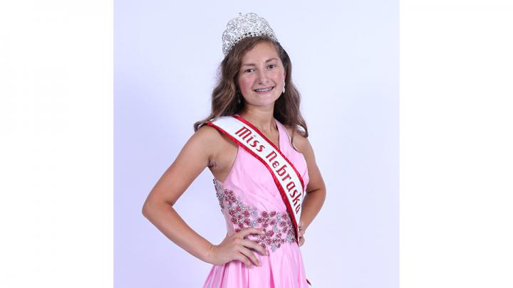 Crowns and Cattle might be my hashtag; however, National American Miss Nebraska Preteen is my title.  I am a small town girl who loves reading, showing cattle, conducting science experiments, and playing board games with my family.  From Gothenburg, NE, I am thirteen year old Lexi Johnson.